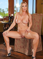 Big ass milf Devon Lee posing nude on armchair