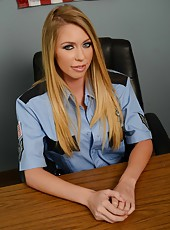 Busty cop with charming blue eyes and great big boobs Brynn Tyler poses on the camera