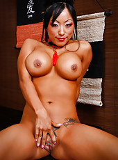 Tempting Asian brunette named Gaia takes off her geisha dress and poses naked