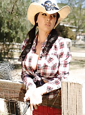 Busty brunette cowgirl Brandy Aniston enjoys sucking and riding big cock