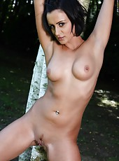 Sexy brunette babe Keira Knight takes off her beautiful dress outdoors