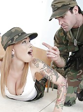 Tattooed redhead girl with huge boobs Scarlett Pain plays with a big machinegun