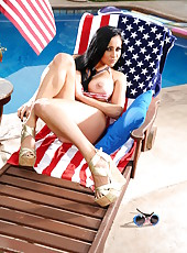 Bewitching brunette babe Audrey Bitoni poses near american flag