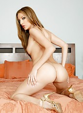 Slender and pale skinned lady Jenna Haze poses in sexy high heels
