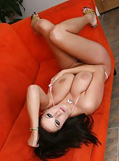 Bewitching brunette bombshell with big natural boobs Gianna Michaels strips