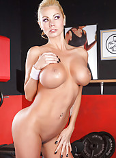 Busty blonde milf Nikita Von James with athletic body spreading her charms