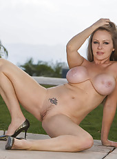Mature babe with sweet face and big tits Dyanna Lauren poses outdoor