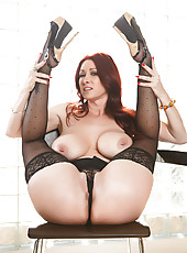 Bewitching redhead lady in sexy lingerie Tiffany Mynx presents great striptease