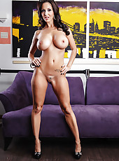 Bewitching brunette milf with huge, perfectly-shaped boobs Ava Addams poses