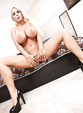 Stunning whore Holly Halston playing with big tits and stripping on her bed