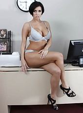 Aesthetic milf Dylan Ryder posing in her office and playing with wet sissy