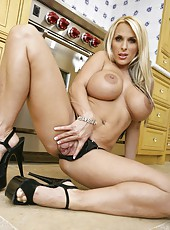 Classy milf Holly Halston wearing high heels and posing in her house
