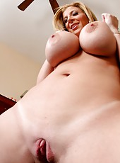 Mature slut Sara Jay demonstrates huge ass and spreads tight pussy