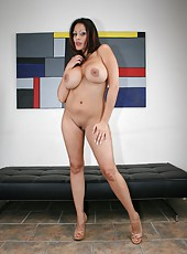 Mature Ava Lauren is stripping down while being filmed in her sexy lingerie