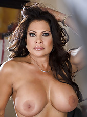Seductive mature brunette Teri Weigel demonstrates her big naked secrets