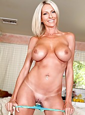 Mature blonde Emma Starr plays with her tanned big tits and touches her shaved pussy