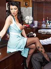 Tattooed business lady Romi Rain seduces bald man with big cock in the office