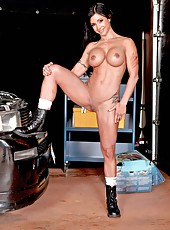Great brunette babe Jewels Jade poses in the garage demonstrating big tits and sweet pussy