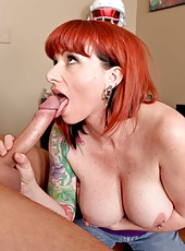 Tattooed redhead with big tits and pierced nipples Kylie Ireland takes a dick