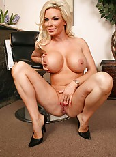Short but busty blonde mature hottie Diamond Foxxx takes off her huge bra and jeans