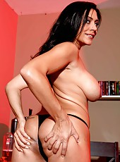 Long legged, big assed and huge titted brunette babe named Raylene demonstrates her charms