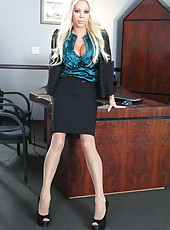 Sumptuous and glamorous blonde milf Nikita Von James poses in her own office