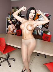 Short-haired brunette coquette Dylan Ryder strips demonstrating her big tits and model body