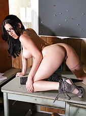 Dangerously hot brunette milf Daisy Cruz presents her curvy body and sexy tattoos