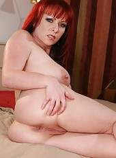 Elegant and fuckable redhead milf Kylie Ireland spreads her butt and shows amazing holes