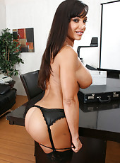 One of the hottest milfs named Lisa Ann presents us her huge tits in the office