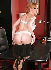 Elegant and stunning mature hottie Tarra White strips and shows her big tits and shaved pussy