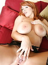 Redhead milf Sienna West takes of a hot black lingerie and rubs her pussy