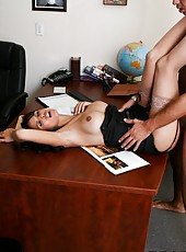 Horny brunette milf Shy Love spreads her legs and shows a trimmed pussy