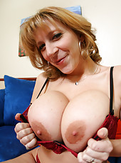 Naughty and busty mature Sara Jay takes off her bra and demonstrates huge boobs