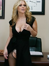 Passionate blonde slut Julia Ann shows her natural tits in the sexy lingerie