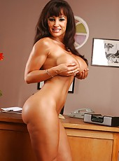 Beautiful and tanned brunette milf Lisa Ann rubs her big boobs and masturbates