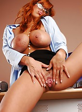 Horny redhead milf Sienna West in sexy glasses poses with her great breast