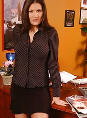 Hot business woman with large round boobs Austin Kincaid strips in her office