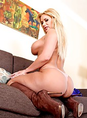 Chic pornstar Shyla Stylez showing massive ass and posing on the sofa