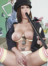 Arresting babe Claire Dames playing with big tits and posing in a hot uniform