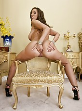Unpredictable milf Kelly Divine stripping in high heels and working with shaved pussy