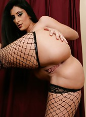 Dark-haired Luscious Lopez posing in high heels and fingering shaved pussy