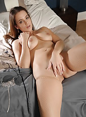 Tenderness babe Natasha Nice starts touching her pussy in the bedroom and continues in the bath