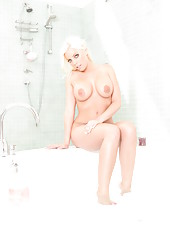 Astonishing blonde goddess Britney Amber nudes in the bathroom and teases us