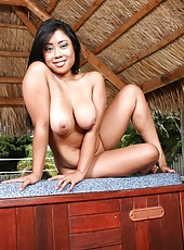 Busty Asian whore Kya Tropic shows her gorgeous body and big tits