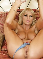Naughty blonde chick Brooke Belle takes off her blue lingerie and masturbates