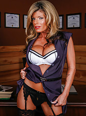 Meet mature blonde cougar Kristal Summers showing off her huge breast