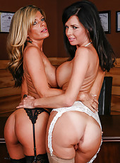 Two lesbian milfs Kristal Summers and Veronica Avluv caressing each other busty body