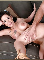 Brunette whore Anjelica Lauren with her huge tits is being nailed hard