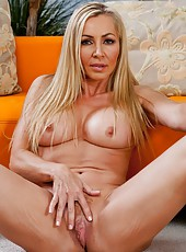 Shameless milf Lisa Demarco taking off clothes and masturbating on camera